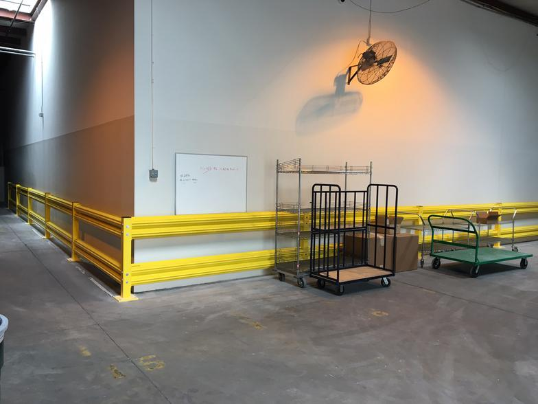 Yellow Safety Warehouse Guardrail Protecting Wall